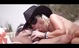 Blonde Milf with cowgirl hat great beach blowjob