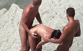 Sharing wife on the beach