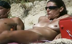 Husband and wife on nudist beach