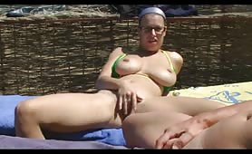 Slutty busty wife masturbates and blows at the beach