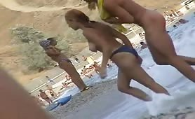 Beach spy cam records topless and naked girls