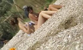 Three beach babes caught naked by voyeur