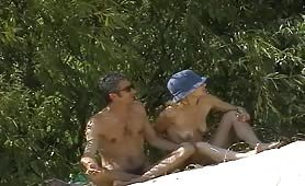 Amateur couple taking a nude sunbath