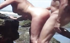 Some amateur doggy style beach sex